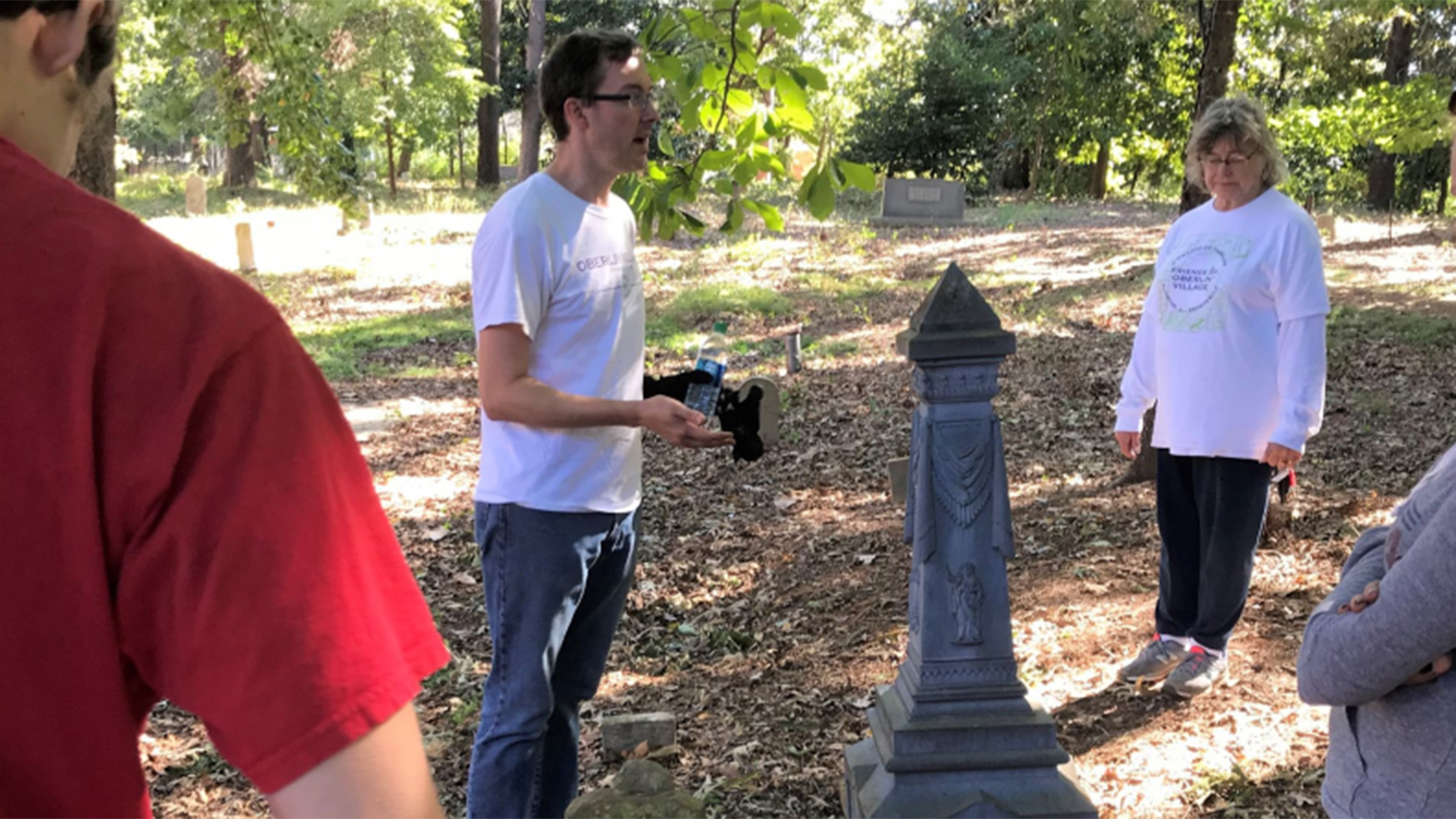man conducts research in cemetery