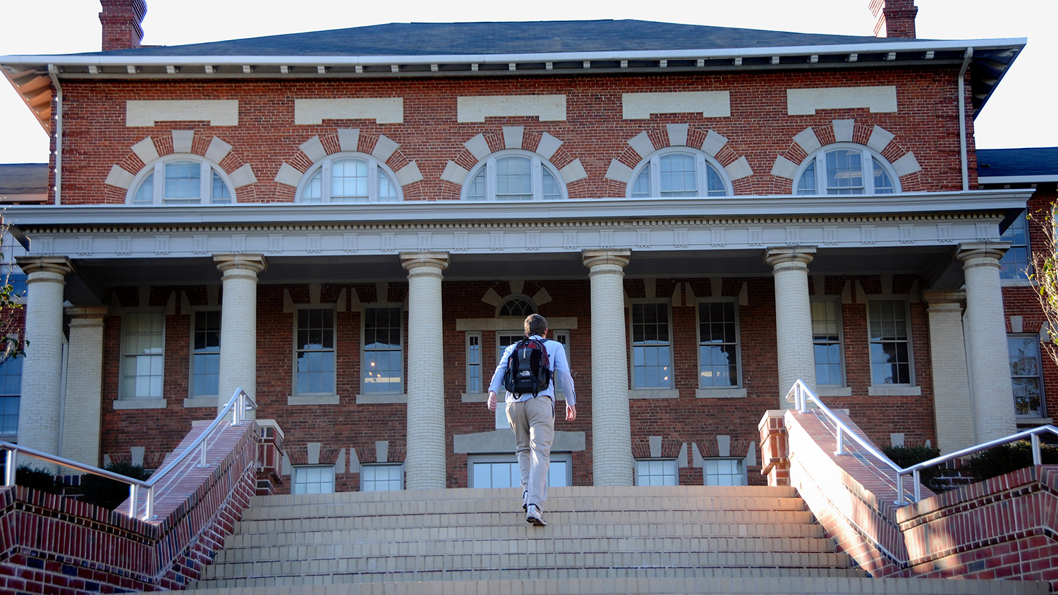 A student walks up the stairs of the 1911 Building