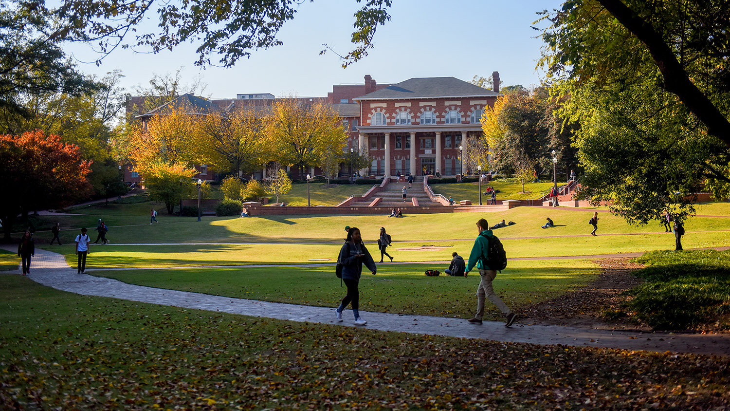 Students walk across NCState's court of north carolina