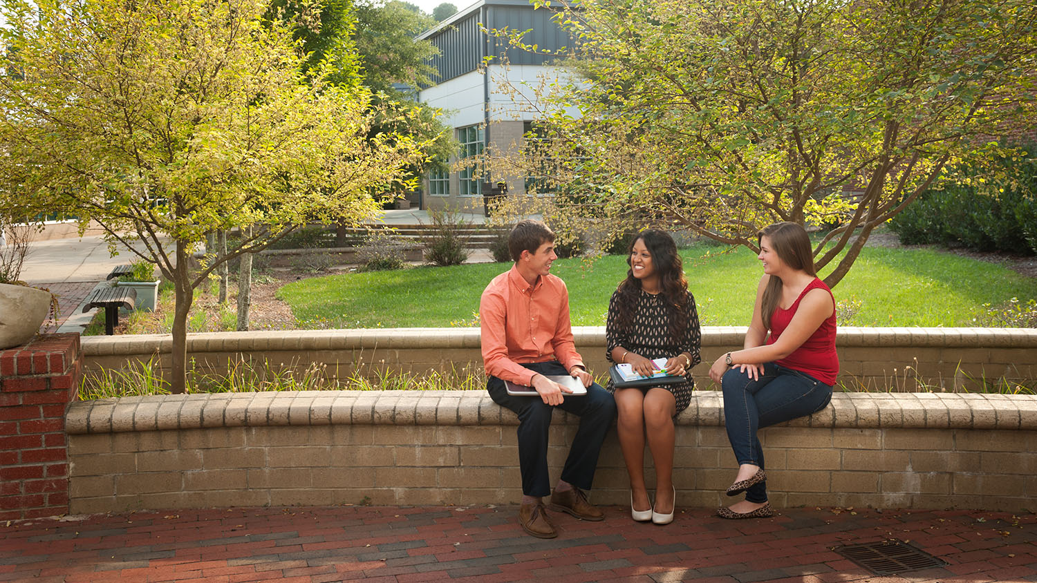 Students talk on NCState's campus